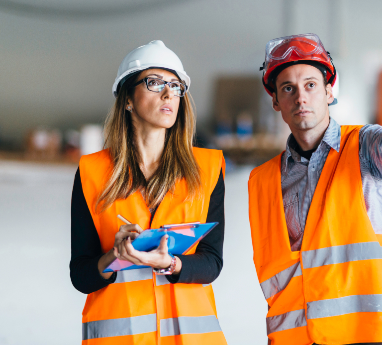 Women wearing high vis, goggles and hard hat